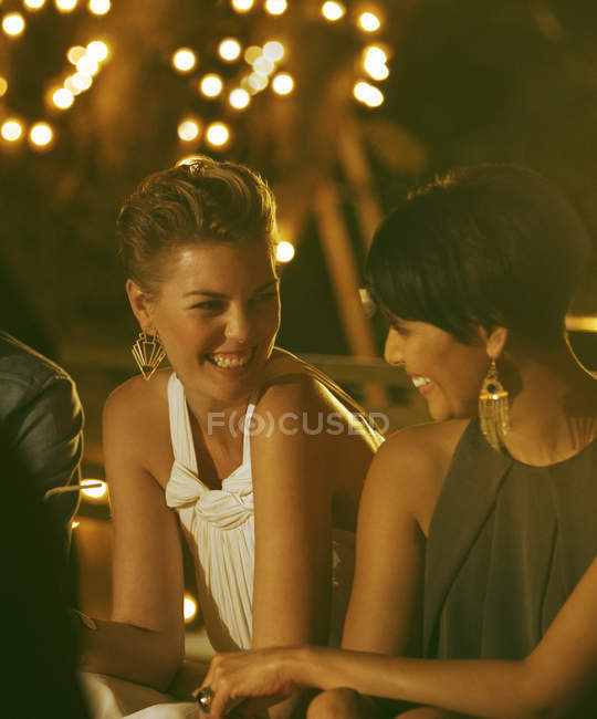 Women laughing at party — Stock Photo