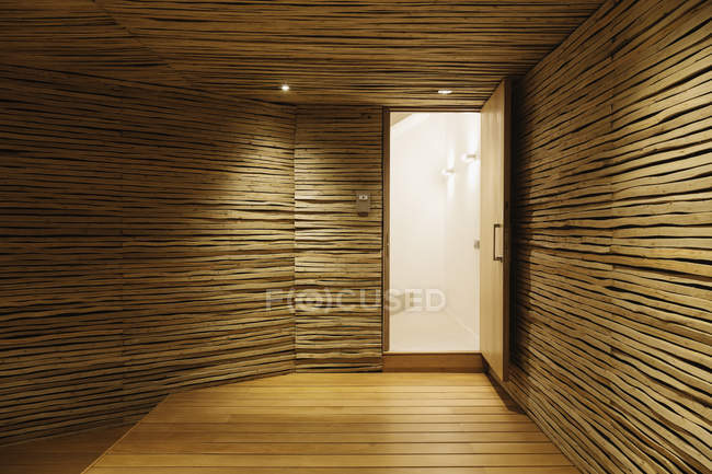 Wooden entry with illumination indoors — Stock Photo