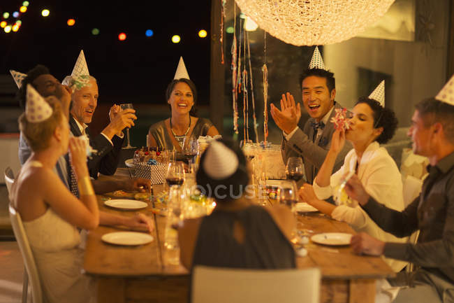 Friends cheering at birthday party — Stock Photo