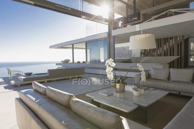 Sunny modern, luxury home showcase interior living room with ocean view — Stock Photo