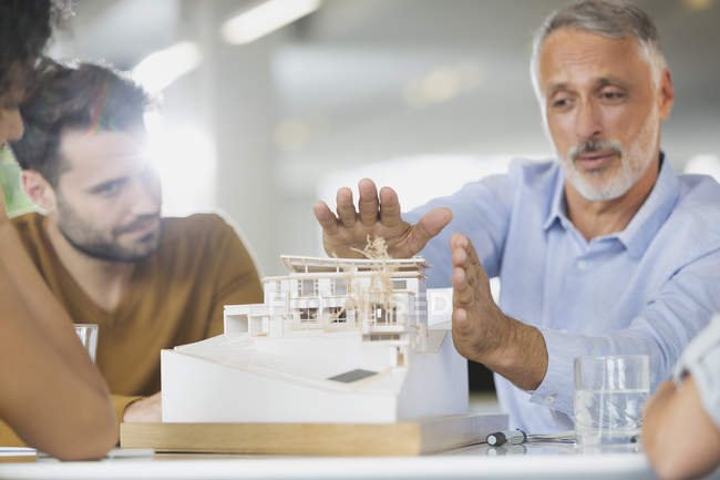 Architects discussing model in meeting — Stock Photo