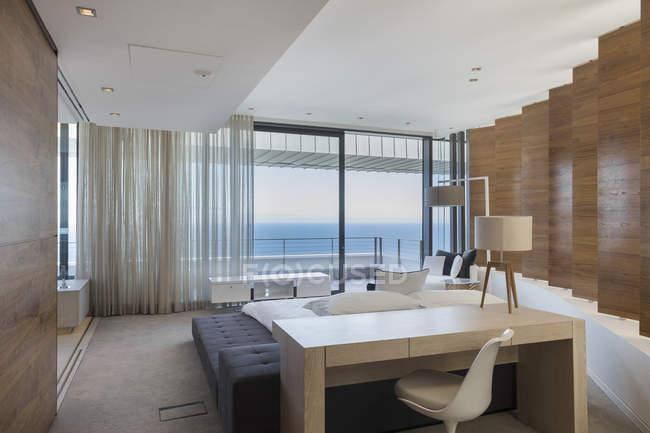 Cozy bedroom interior in modern house — Stock Photo