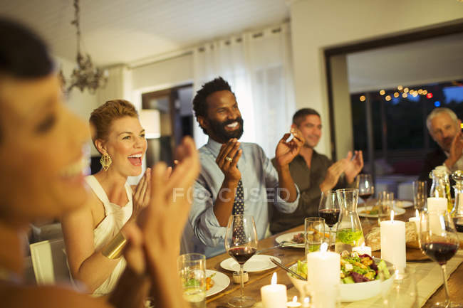 Friends cheering at dinner party — Stock Photo