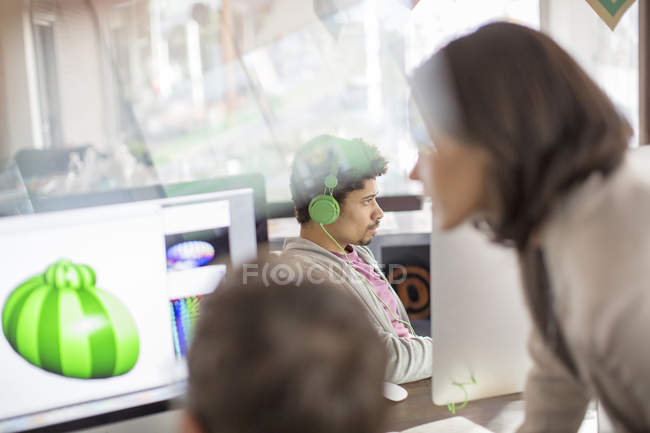 Creative graphic designers working at computers in office — Stock Photo