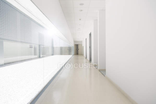 Long empty corridor with white walls — Stock Photo