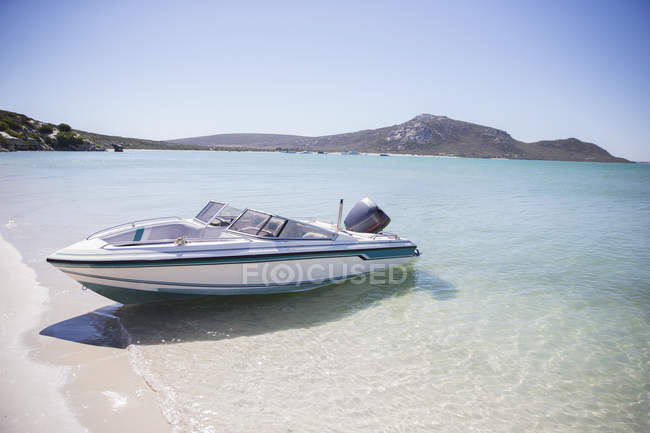 Speedboat beached on shore — Stock Photo