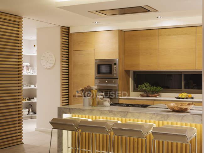 Wooden cupboards in modern luxury home showcase kitchen \u2014 Stock Photo & Wooden cupboards in modern luxury home showcase kitchen \u2014 Stock ...