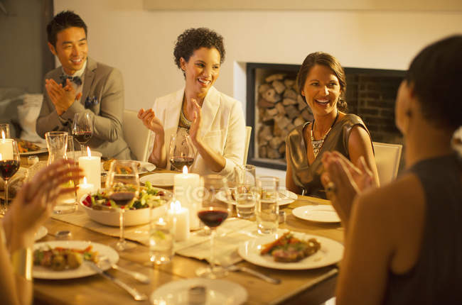 Friends applauding at dinner party — Stock Photo