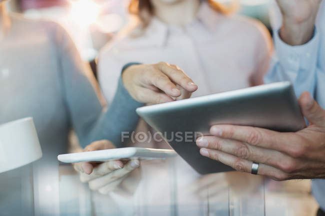 Close up business people using digital tablets — Stock Photo