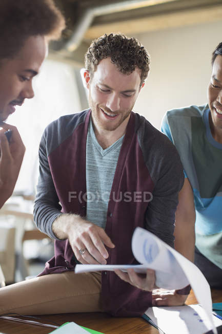 Creative businessmen discussing paperwork in meeting — Stock Photo