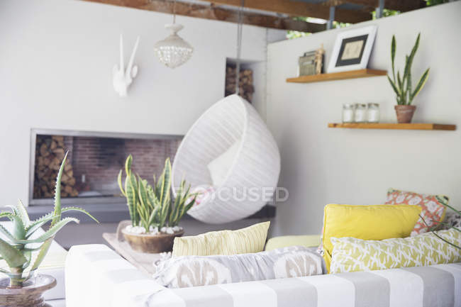 Sofa, chair and fireplace in modern living room — Stock Photo