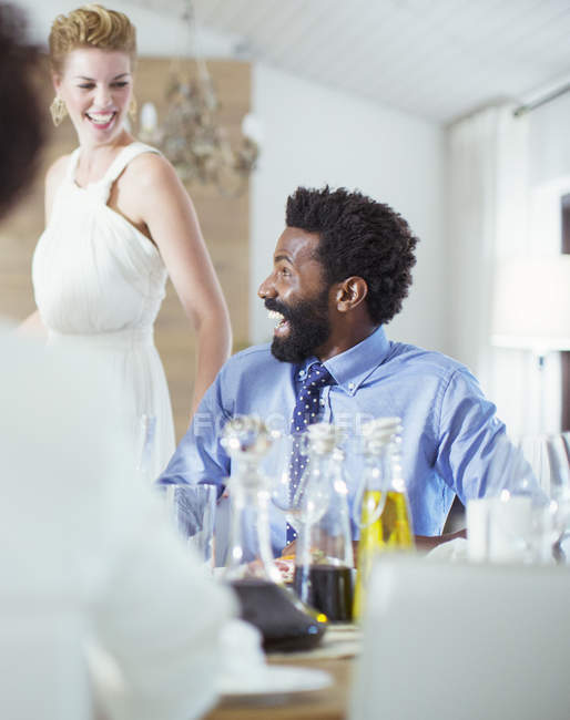 Man laughing at dinner party — Stock Photo