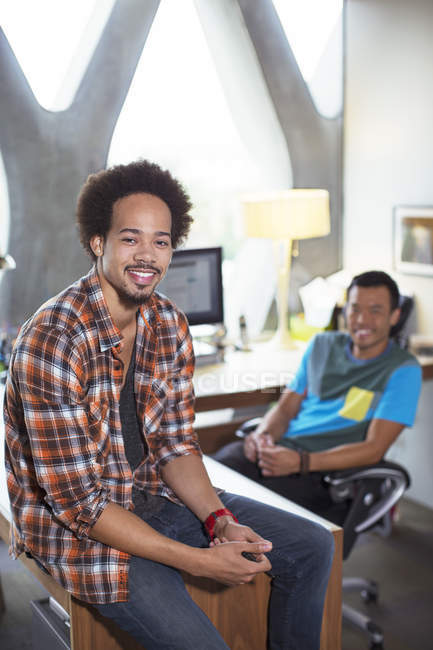 Portrait of confident casual businessmen in office — Stock Photo