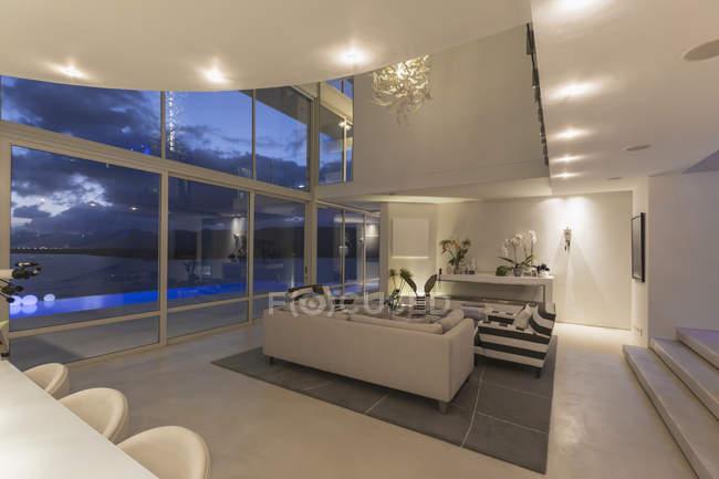 illuminated modern luxury home showcase interior at night stock