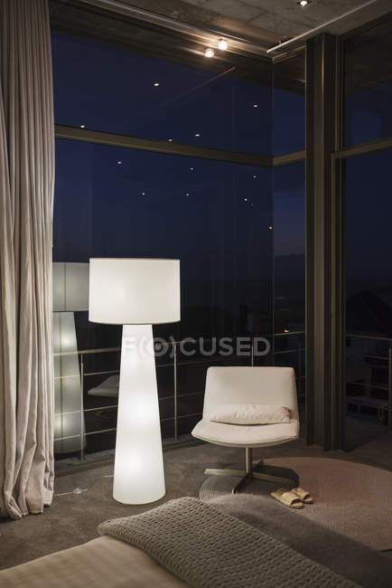 Lamp and chair in corner of modern bedroom — Stock Photo