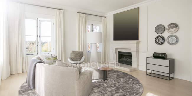 Home showcase living room with marble fireplace — Stock Photo
