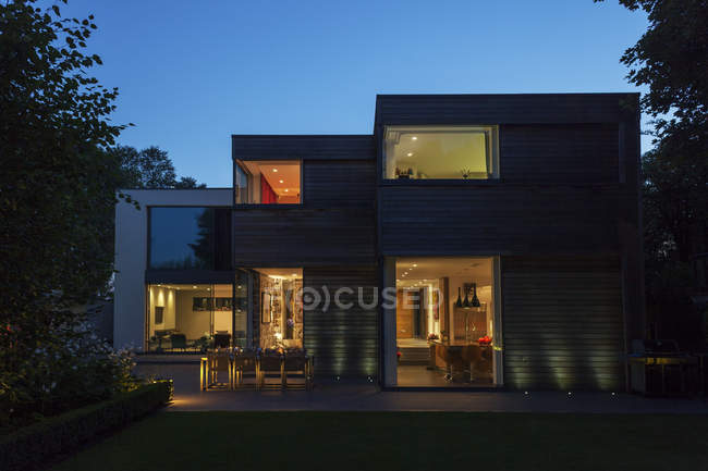 Modern house illuminated at dusk — Stock Photo