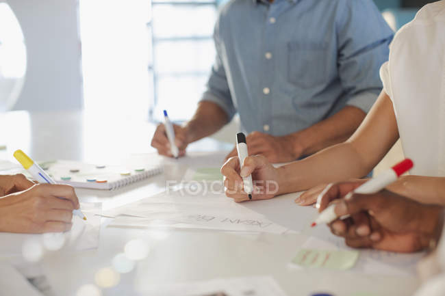 Creative entrepreneurs brainstorming, writing ideas — Stock Photo