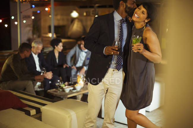 Couple kissing at party — Stock Photo
