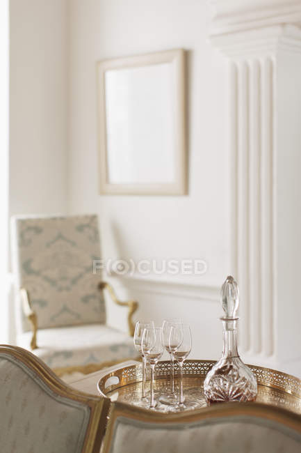 Crystal sherry decanter and cordial glasses in luxury living room — Stock Photo