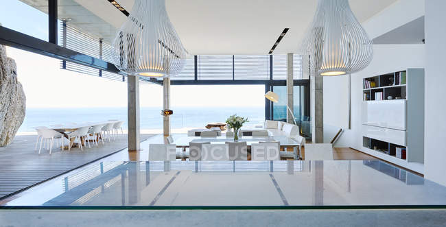 Room at luxury modern house against sea — Stock Photo