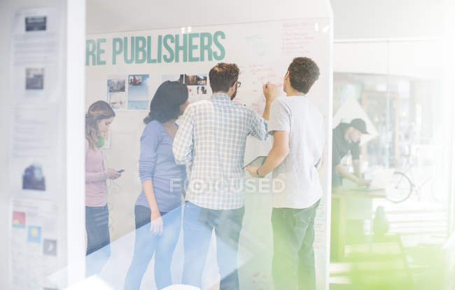 Publishers brainstorming at whiteboard in office — Stock Photo