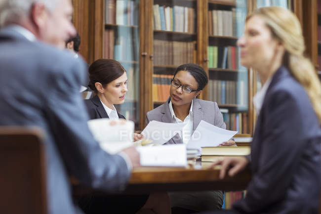 Lawyers examining documents in chambers — Stock Photo