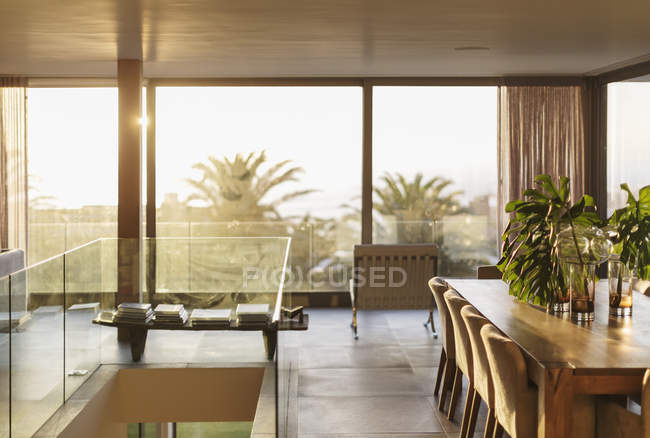 Scenic view of sunny modern dining room — Stock Photo