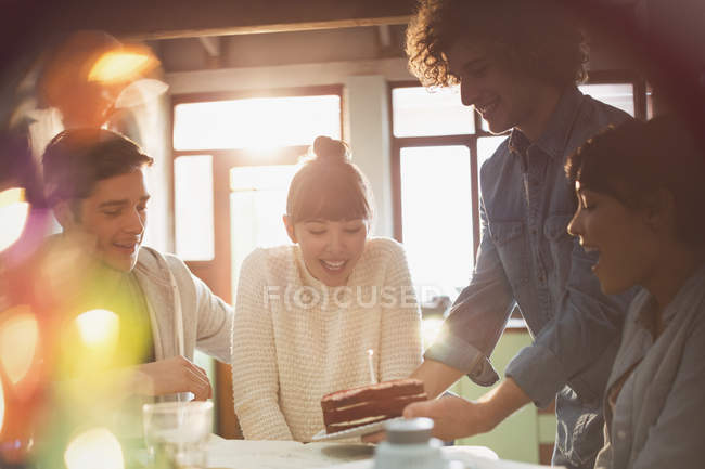 Young friends celebrating birthday with cake and candle — Stock Photo