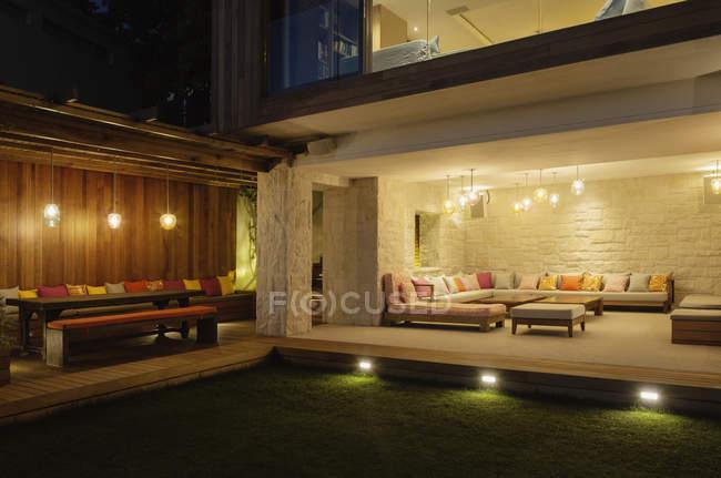 Illuminated patios with benches at night — Stock Photo