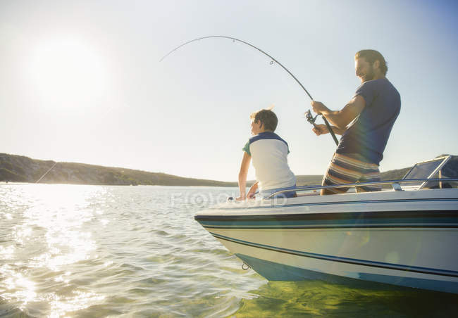 Father and son fishing on boat — Stock Photo