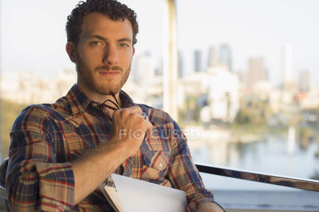 Portrait of serious casual businessman in modern office — Stock Photo