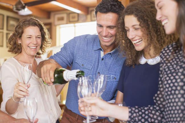 Happy beautiful family celebrating with drinks — Stock Photo