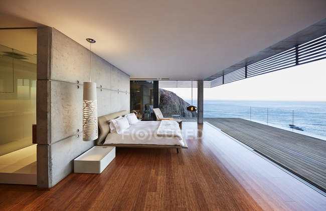 Luxury modern house with  terrace against sea water — Stock Photo