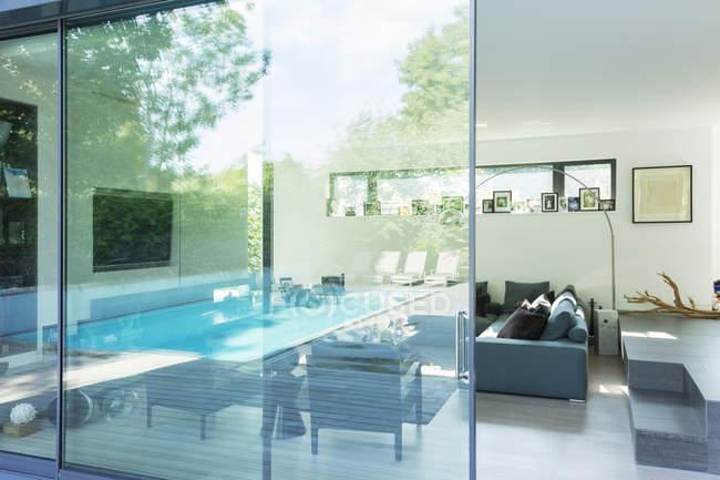 Reflection on glass window of modern house — Stock Photo