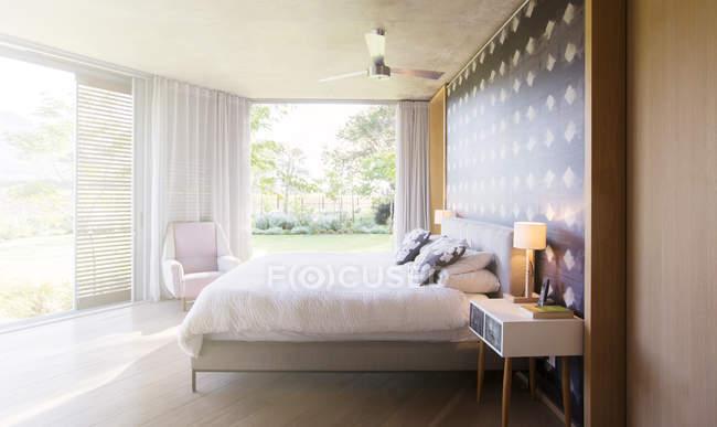 Luxury bedroom open to yard — Stock Photo