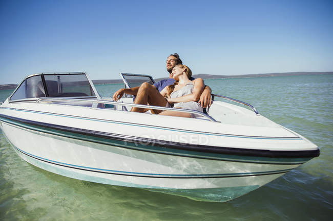 Couple sitting in boat on water — Stock Photo