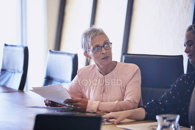 Attentive businesswoman listening in conference room meeting — Stock Photo