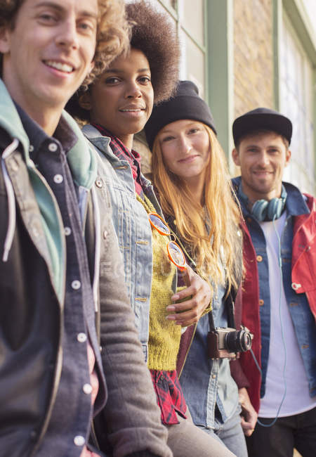 Happy young friends standing together — Stock Photo
