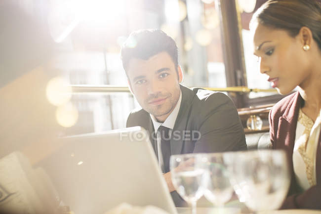 Young handsome businessman smiling in restaurant — Stock Photo