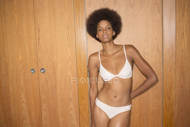 Woman wearing bra and panties at home — Stock Photo