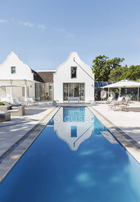 Luxury house and lap pool outdoors — Stock Photo