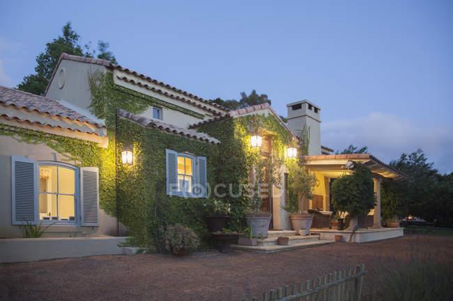 Luxury villa illuminated at night — Stock Photo