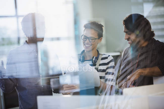 Business people planning, discussing paperwork in office — Stock Photo