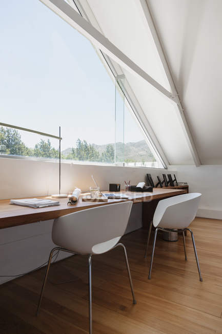 Table at window in modern office during daytime — Stock Photo