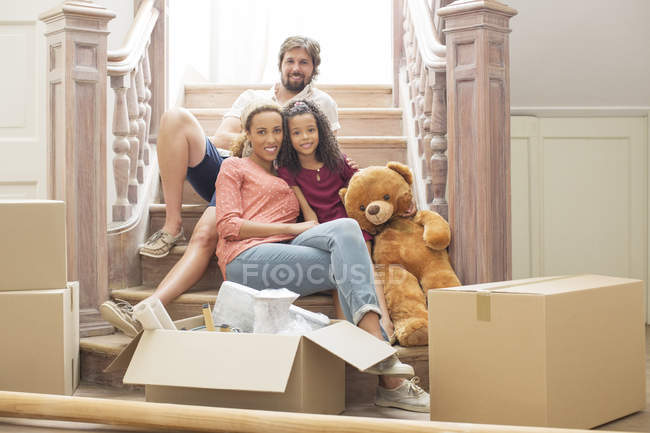 Family sitting on stairs together — Stock Photo
