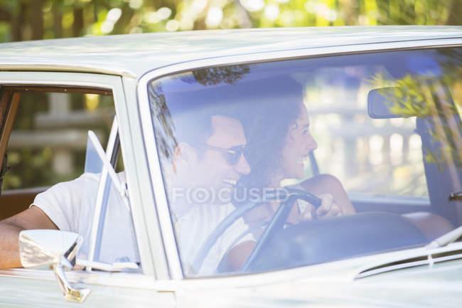 Couple enjoying car ride on sunny day — Stock Photo