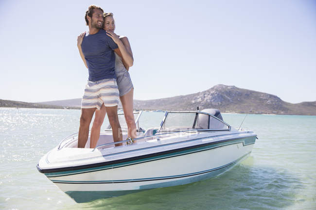 Couple standing on boat together — Stock Photo
