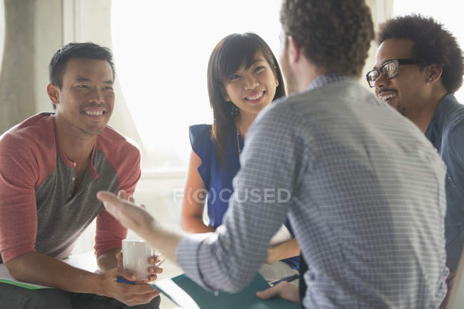 Happy creative business people in meeting — Stock Photo