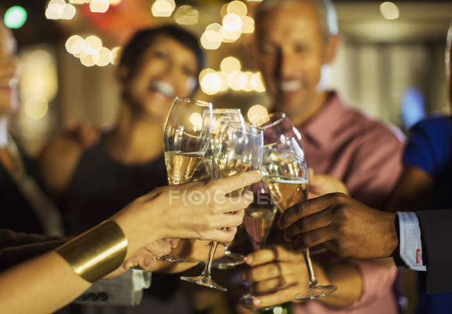 Friends toasting each other at party — Stock Photo